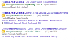 "various ad extensions being displayed for ads when typing in the keyword ""heating and cooling"""