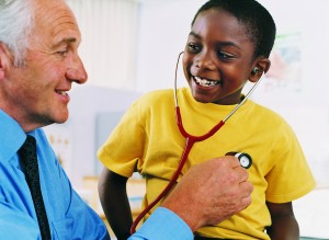 Pediatrician with boy patient. Personalize marketing - business is about relationships between people